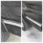 Paintless dent repair performed on the back end of a black truck