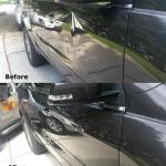 Side of a black truck repaired with paintless dent repair